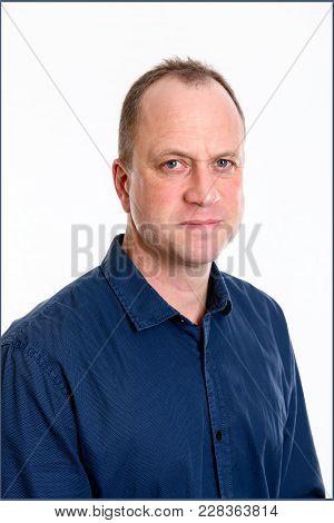 Portrait Of A  Man In Blue Shirt
