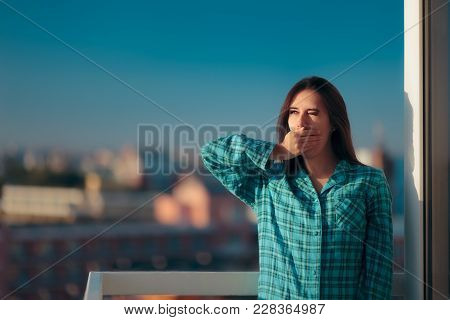 Sleepy Morning Woman In Pajamas Yawning In The Balcony