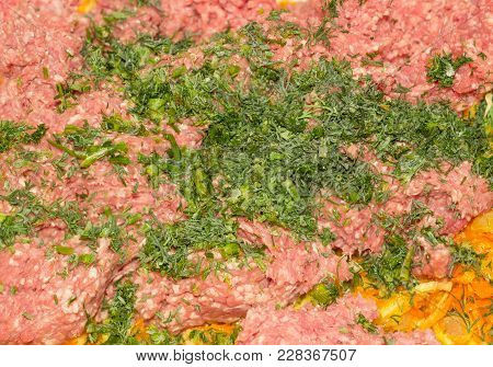 Background Of The Ground Meat On A Sauteed Onions And Carrots And Sprinkled With Chopped Dill During