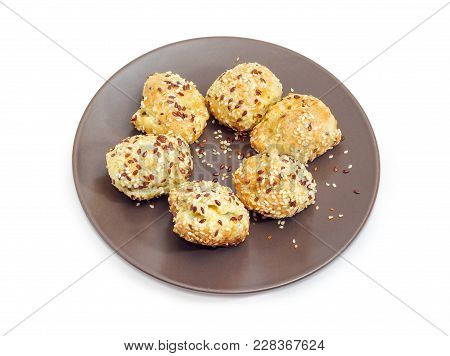 Savory Profiterole Filled With Cheese And Sprinkled With Flax Seeds And Sesame Seeds On The Brown Di