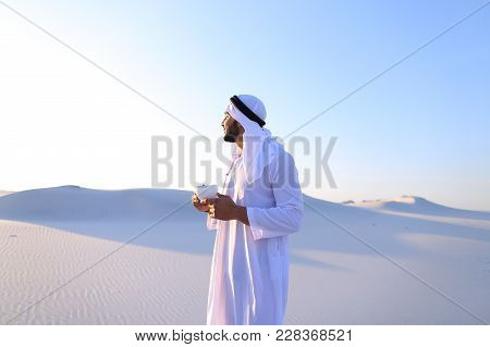 Portrait  Confident And Happy Male Muslim Who Drinks Invigorating Coffee Drink From White Cup And En