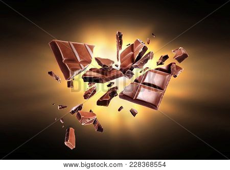 Chocolate Broken Into Pieces In The Dark