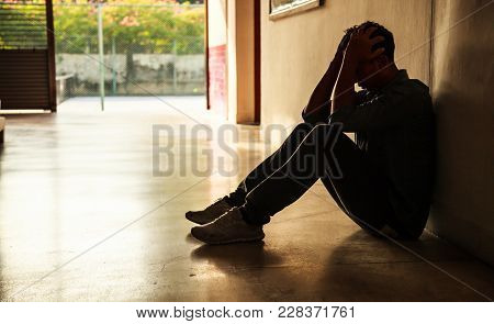 Emotional Moment: Man Sitting Holding Head In Hands, Stressed Sad Young Male Having Mental Problems,