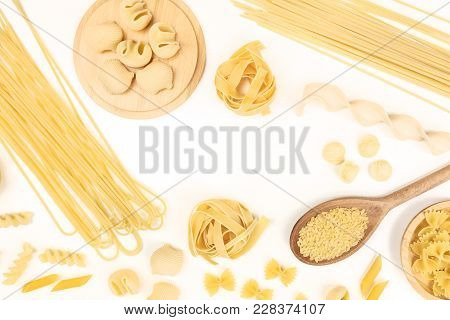 An Overhead Photo Of Different Types Of Pasta, Including Spaghetti, Penne, Fusilli, And Others, Form