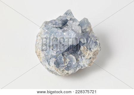 Blue Quartz Ore On White Background, Blue Quartz Contains Inclusions Of Fibrous Magnesio-riebeckite