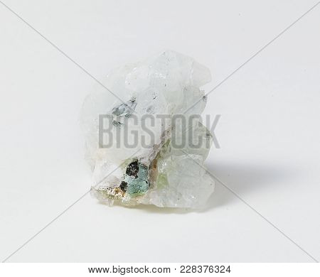 White Apophyllite Ore  On White Background. The Name Apophyllite Refers To A Specific Group Of Phyll