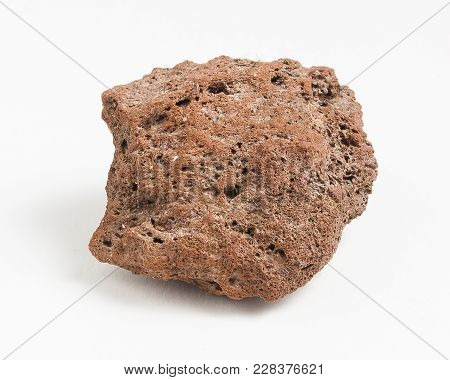 Vulcanic Rock Ore On White Background. Volcanic Rock (often Shortened To Volcanics In Scientific Con