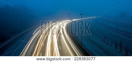 Morning, Intensive Traffic On The Urban Road Thoroughfare In Difficult Road Conditions, Fog And Dark