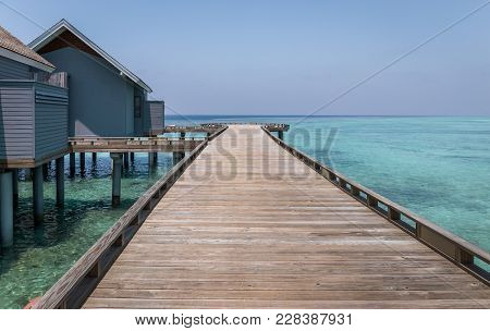 Wooden Jetty In Exotic Maldives