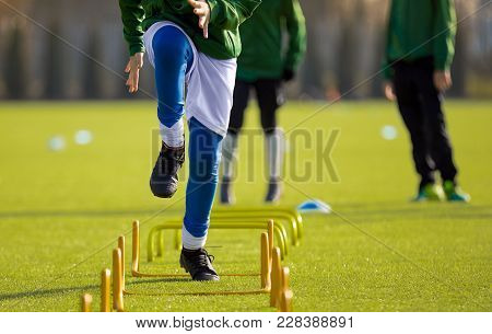 Boy Football Player In Training With Ladder. Young Soccer Players At Training Session. Soccer Speed