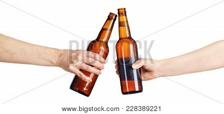 Female Hands With Cold Beer Brown Bottles, Isolated On White Background. Beer Up. Cheers. Pair Of Be