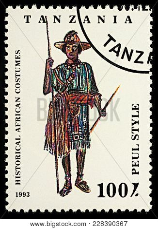 Moscow, Russia - February 26, 2018: A Stamp Printed In Tanzania, Shows African Man In Traditional Cl