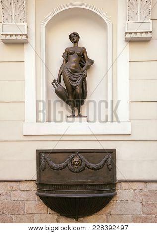 Woman Statue In A Wall Niche In Riga, Latvia