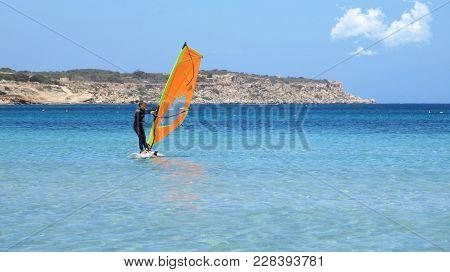 Windsurfing Girl Enjoying A Summer Day In A Mediterranean Sea In Malta