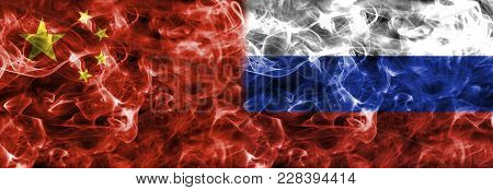 Russia And China Smoke Flag Isolated On A Black Background