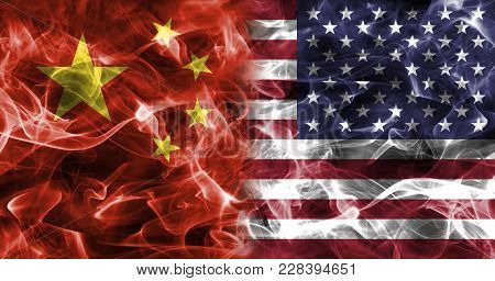 China And Usa Smoke Flag Isolated On A Black Background