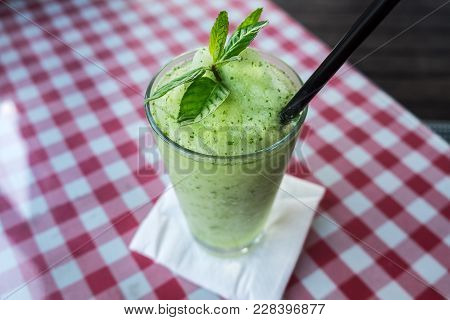 Non Alcoholic Mint And Ice Lemonade On Table At Small Cafe