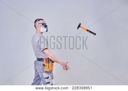 Master Builder-finisher In Work Clothes, Throws A Hammer For Any Purpose