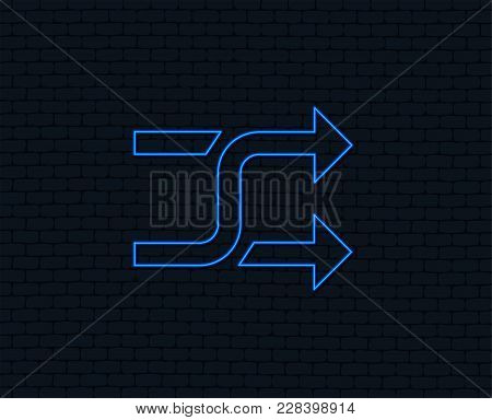 Neon Light. Shuffle Sign Icon. Random Symbol. Glowing Graphic Design. Brick Wall. Vector