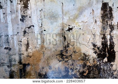 Brown Concrete Wall With A Black Stains Dark Atmospheric Background, Texture