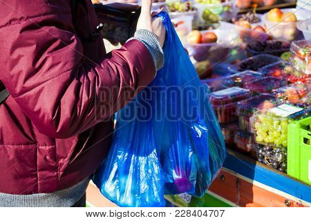 Male Consumer At An Open Street Market Shopping Fruit And Vegetables. Street Market. Helthy Food. Fr