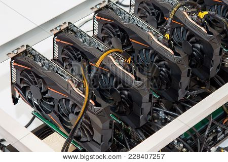 Graphics Cards Standing In A Row In Home Mining Farm. Close-up Shot. Cryptocurrency Industry