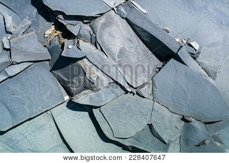Close-up Natural Gray Stony Uneven Background Consisting Of Pieces Of Splited Mountain Slate.