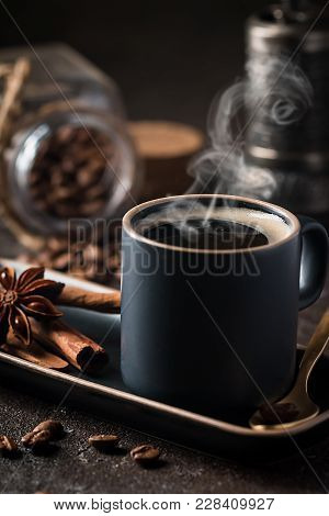Fresh Tasty Black Espresso Cup Of Hot Coffee With Cinnamon, Anise Stars And Coffee Beans On Dark Bac