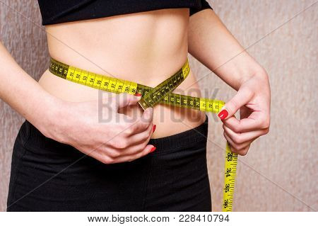 Beautiful Girl Who Adheres To Diet, Measures  Waist