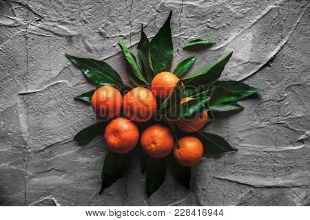Tangerines (oranges, Mandarins, Clementines, Citrus Fruits) With Leaves On Gray Cement Background. O