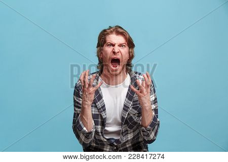 Screaming, Hate, Rage. Crying Emotional Angry Man Screaming On Blue Studio Background. Emotional, Yo