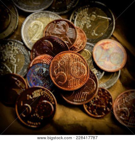 Coin Of Five Euro Cents Lies On The Background Of Coins. Euro Money.  Currency Of The European Union