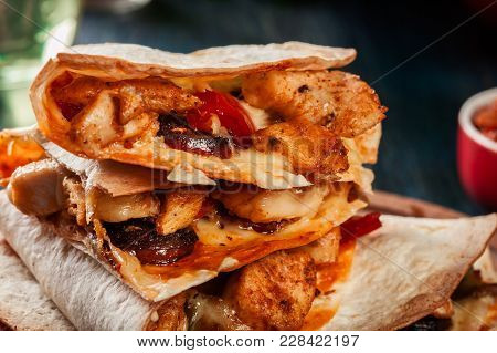Stack Of Quesadillas With Chicken, Sausage Chorizo And Red Peppe