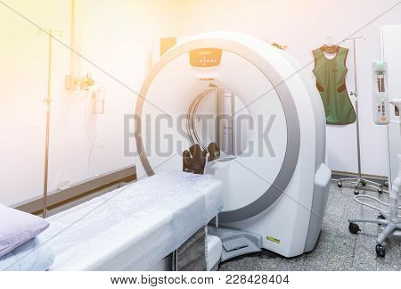 Ct Scan Machine In Room With Medical Equipment.