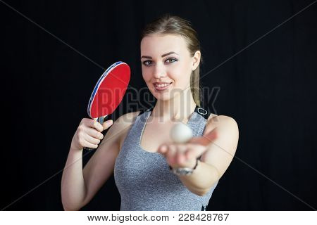 Beautiful Girl With A Tennis Racket And A Ball.