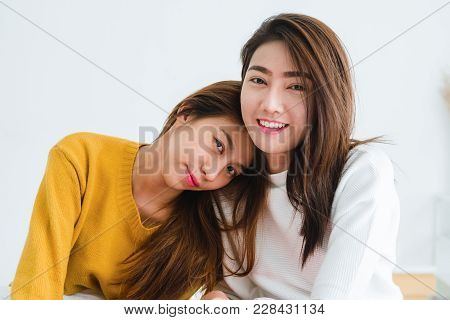 Beautiful Young Asian Women Lgbt Lesbian Happy Couple Sitting On Bed Hugging And Smiling Together In