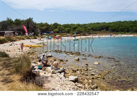 Premantura, Croatia - July 28: Tourists On Kamenjak Peninsula Beach By The Adriatic Sea On July 28,