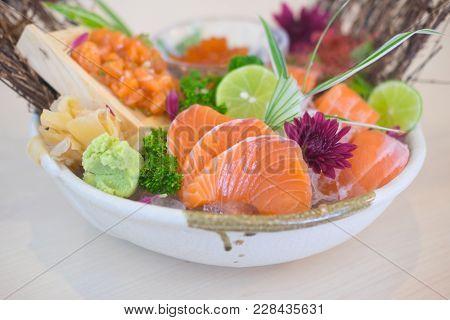 Sashimi With Mixed Sliced Fish Sashimi On Ice In With Bowl.