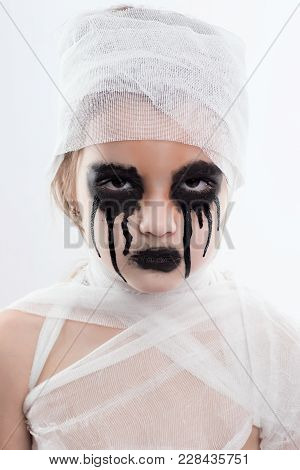 Teenager Girl With Mummy Bandages On Halloween On White Isolated Background