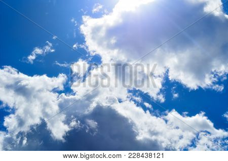 Sky Background. Natural Landscape Of Cloudy Sunset Sky With Dramatic Clouds. Blue Sky Background Wit