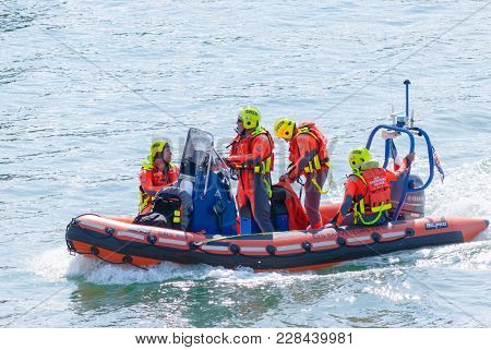 Fecamp-france, September 16,2017 - Scene Of Four French Man Coast Guard Crew On Boat In Costume Oran