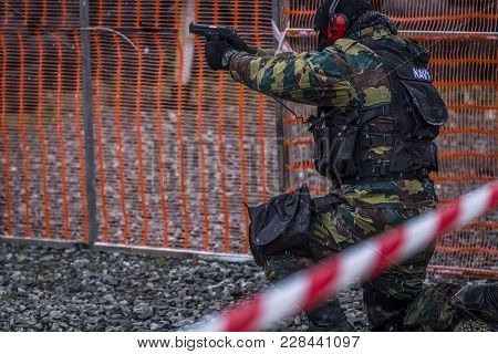 Soldiers Train Shooting With A Gun. A Group Of Soldiers Are Practicing In Cold Snowy Weather. Perfec