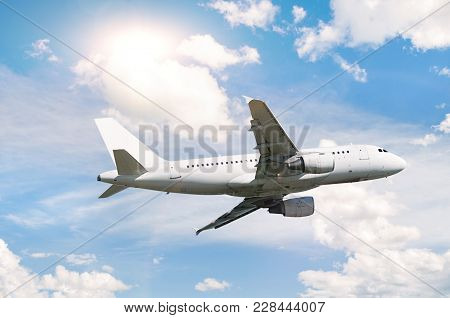 Airplane Flying In The Sunset Sky, Travel Background With Commercial Flying Airplane. Airplane In Th