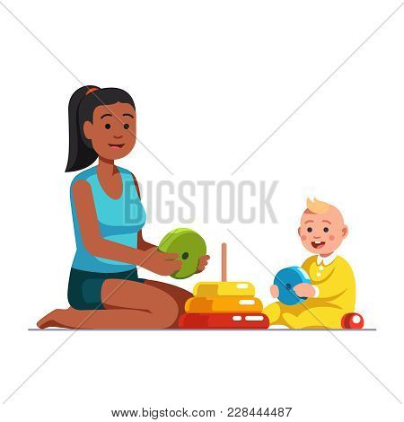 Afro American Babysitter Or Stepsister Playing Educational Game Together With Baby Boy, Building Sta