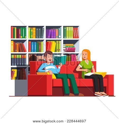 Two Bookworms Family Couple Reading Books Together, Talking Sitting On Couch In Front Of Big Library