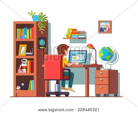 Student Boy Sitting At Home Office Desk, Doing School Homework, Surfing Internet On Laptop Computer.