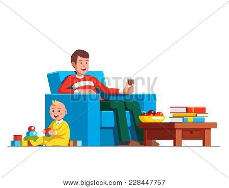 Father Drinking Red Wine And Looking After Little Baby Son Playing Toys. Babysitter Man Sitting With