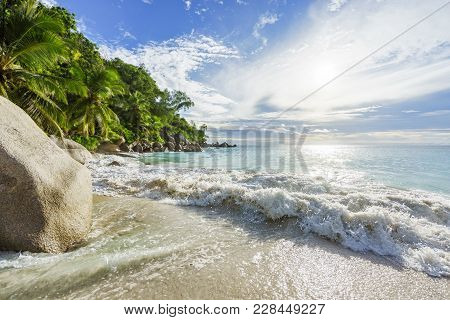 Paradise Tropical Beach With Rocks,palm Trees And Turquoise Water In Sunshine, Seychelles 17