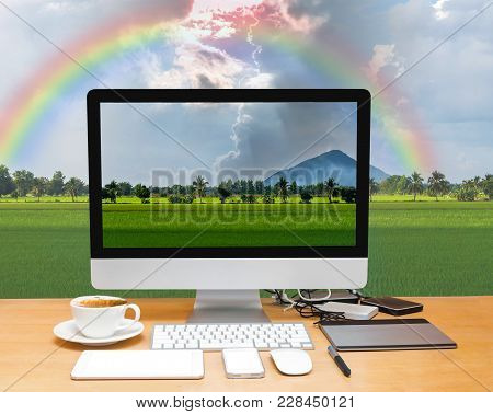 Conceptual Image Of A Workspace With Computer Desktop On Beautiful Nature View,mountain With Rice Fi