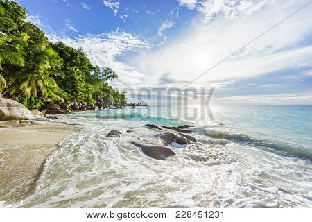 Paradise Tropical Beach With Rocks,palm Trees And Turquoise Water In Sunshine, Seychelles 19